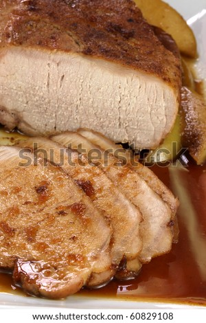 fine pork tenderloin slow roasted  with fresh green apple wedges and apple sauce