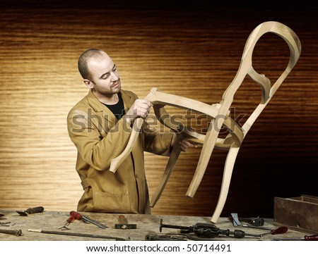 fine portrait of craftsman at work isolated and wood background