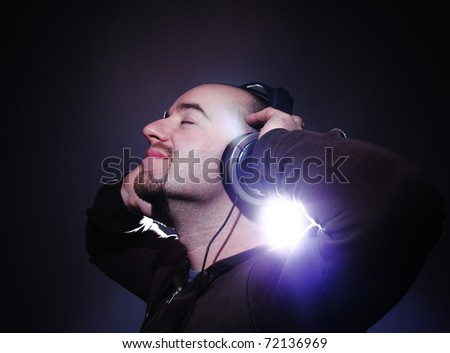 fine portrait of man listening music with headphone