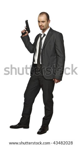 fine portrait of young caucasian man holdin a pistol isolate on white background