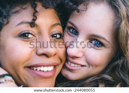 fine portrait with two girls of different ethnicity