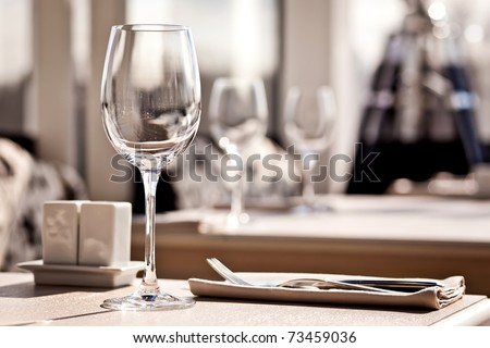 Fine restaurant dinner table place setting: napkin & wineglass