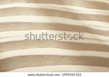 Fine sand background and stone objet Photo stock ©