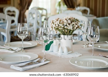 Fine table setting in beautiful gourmet restaurant