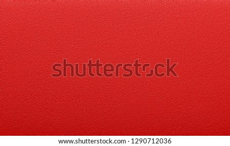 Photo of  Fine texture of natural animal skin. Saturated red color. Expensive finish products. Luxury background