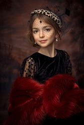 fineart portrait of a little girl in a vintage hat and red fur cape, looking royal, liitle lady, studio portrait