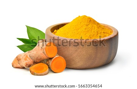 Finely dry Turmeric (Curcuma longa Linn) powder in wooden bow with  rhizome (root) sliced isolated on white background.