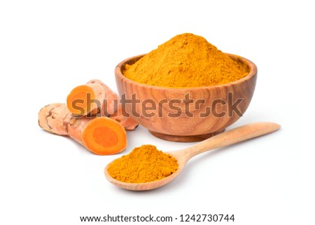 Finely dry Turmeric (Curcuma longa Linn) powder in wooden bowl and spoon with  rhizome (root) isolated on white background.