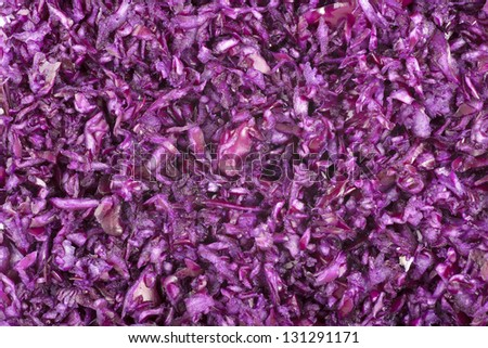 Finely grated red cabbage filling frame for food background