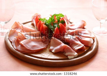 Finest gammon with slices of tomatoes and parsley