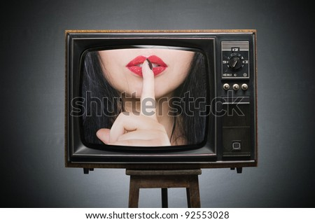 Finger a present to the red lips on the screen of the old TV. secret