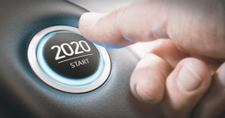 Finger about to press a car ignition button with the text 2020 start. Year two thousand and twenty concept.