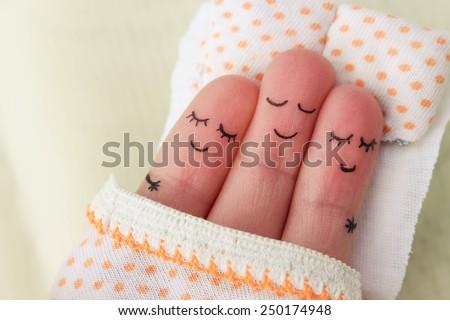 Finger art. Happy man sleeps with two women.
