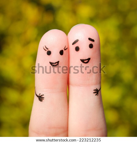 Finger art of a Happy couple. A man and a woman hug on the background of yellow leaves #223212235