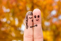 Finger art of a Happy couple. Girl kisses boy on the cheek.