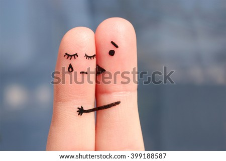 Finger art of displeased couple. Woman cries, man reassures her. He kisses and hugs.