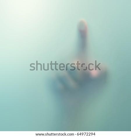 finger on blue glass