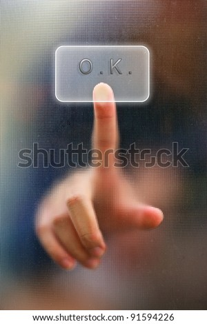 finger on glass as blur background