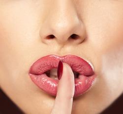 finger on lips - silent gesture
