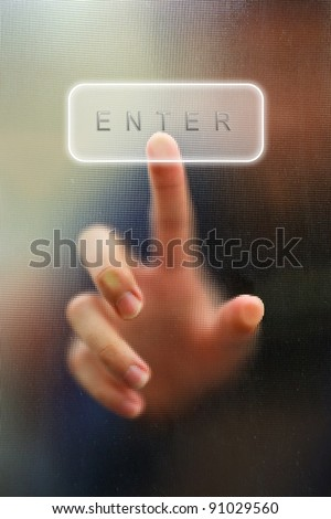 finger point as blur motion on enter key as background