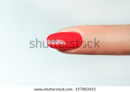 finger point isolated white background with nail polish