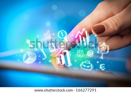 Finger pointing on tablet pc, charts concept