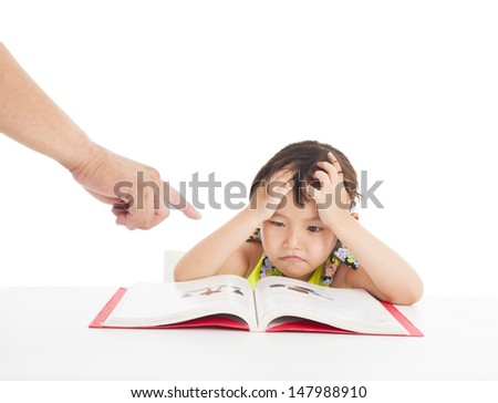 finger pointing to Angry and tired little girl studying
