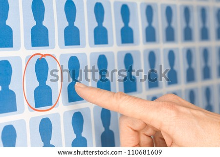 Finger Pointing to Selected Blue Figure - Human Resources Concept