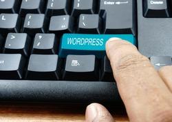 Finger press blue Wordpress keyboard button