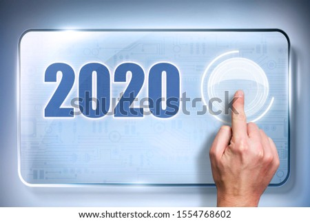 finger presses a button with a loading bar on a touchscreen to load up 2020 #1554768602