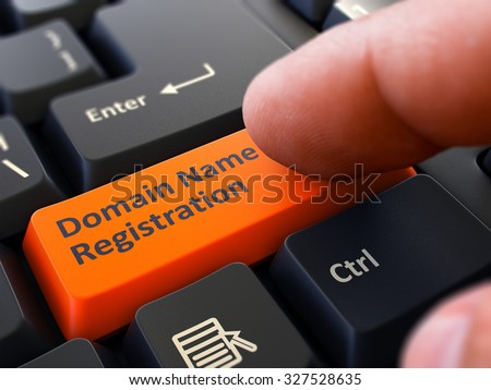 Finger Presses Orange Button  Domain Name Registration on Black Keyboard Background. Closeup View. Selective Focus. Stock photo ©