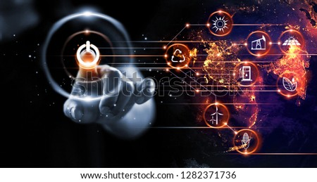 Finger pressing power button with energy resources icon on earth at night background. Earth day. Environment and conservation. Energy saving concept.