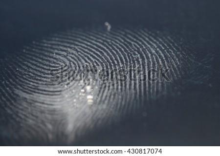 finger print and finger on black screen  #430817074