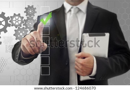 Finger pushing button on a touch screen interface