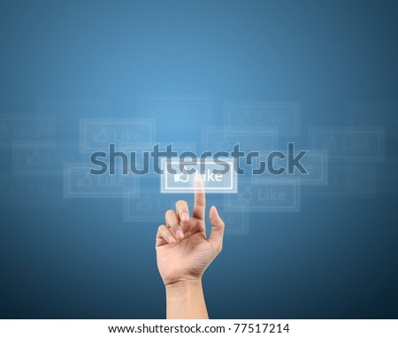 finger pushing the like button for social network concept