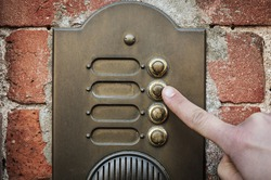 finger ringing a door bell