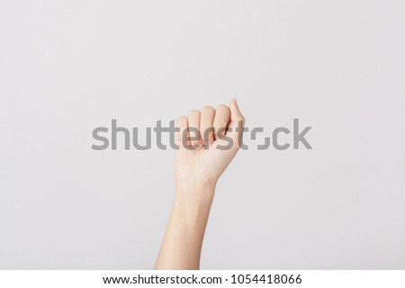 Finger Spelling the Alphabet in American Sign Language (ASL). The Letter A #1054418066
