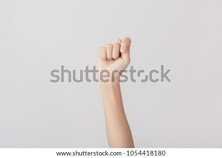 Finger Spelling the Alphabet in American Sign Language (ASL). The Letter T #1054418180
