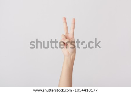 Finger Spelling the Alphabet in American Sign Language (ASL). The Letter V #1054418177