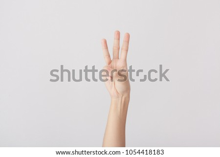 Finger Spelling the Alphabet in American Sign Language (ASL). The Letter W #1054418183