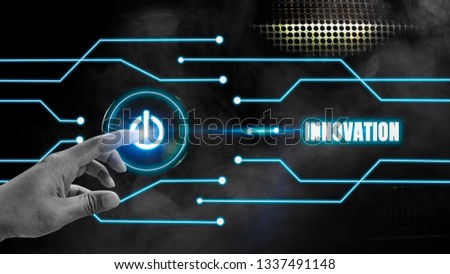 Finger touch button on-off glows on a black metal background And blue glow lines with innovation concept, the development of technology and the change of the world. with disruptive technologies #1337491148