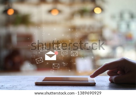 finger touch mobile check e-mail on coffee shop background with copy space. Communication concept. Double exposure