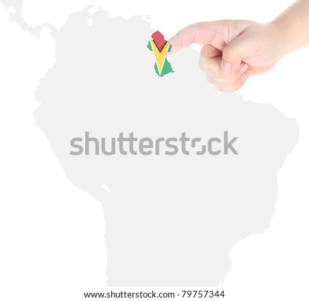 Finger touch on a future innovative transparent screen display map and flag of Guyana