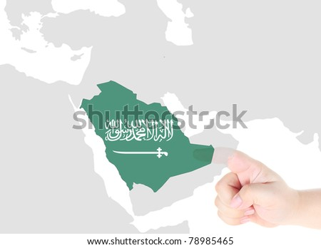 Finger touch on a future innovative transparent screen display Saudi Arabia map and flag