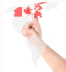 Finger touch on a future innovative transparent touch screen display Canada flag and map