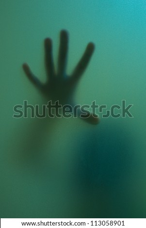 finger touch to frosted glass seem like ghost use for halloween