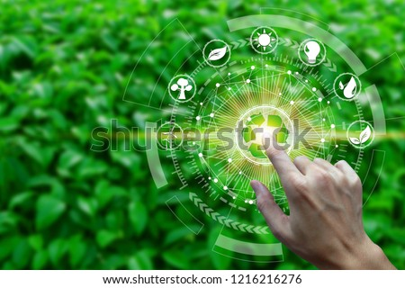 Finger touch with environment Icons over the Network connection on nature background, Technology ecology concept.