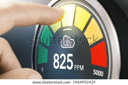 Finger touching digital screen of a CO2 monitor to measure indoor air quality and carbon dioxide concentration. Composite image between a hand photography and a 3D background. Stock photo ©