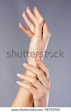 Fingernail. Beautiful woman hand with france manicure