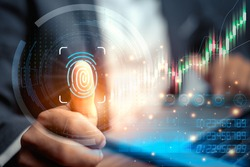 Fingerprint scan provides security access with biometric identification. Businessman using fingerprint indentification to access personal financial data. Technology Safety and biometric security.